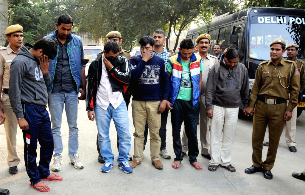 Delhi Police presents before press six people arrested in connection with the theft  of memory cards worth Rs 40 lakhs from  Cargo hub of Indira Gandhi International Airport in New Delhi, ...