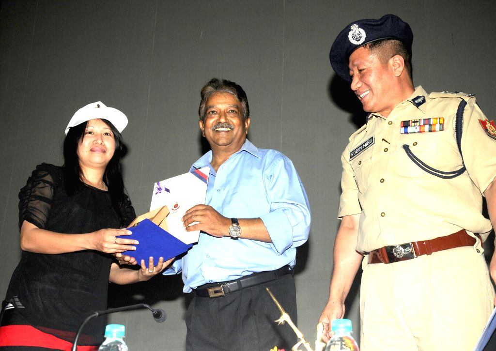 Delhi Police special commissioner (law and order) Deepak Mishra facilitates an activist from North-Eastern states at Hindi Bhawan in New Delhi on May 9, 2014. - Deepak Mishra