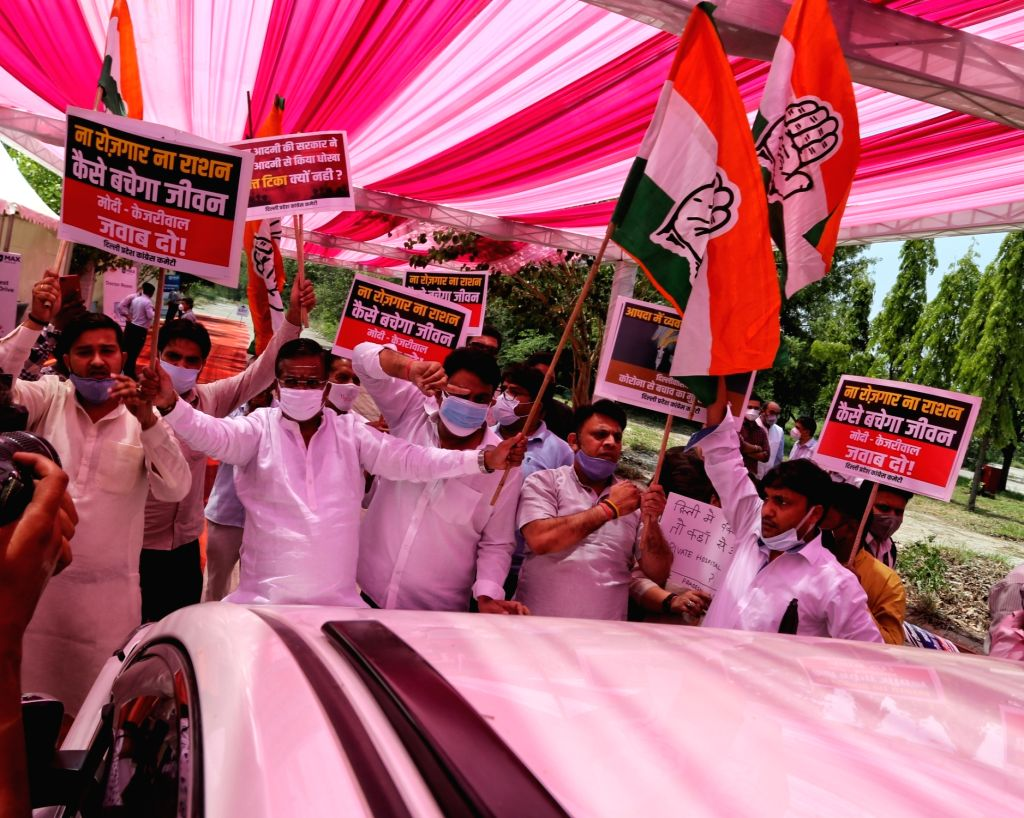 Delhi Pradesh Congress Committee (DPCC) workers protest outside the drive-in vaccination centre at Akshardham, as the Delhi Government is denying free vaccination to the poor in New Delhi ...
