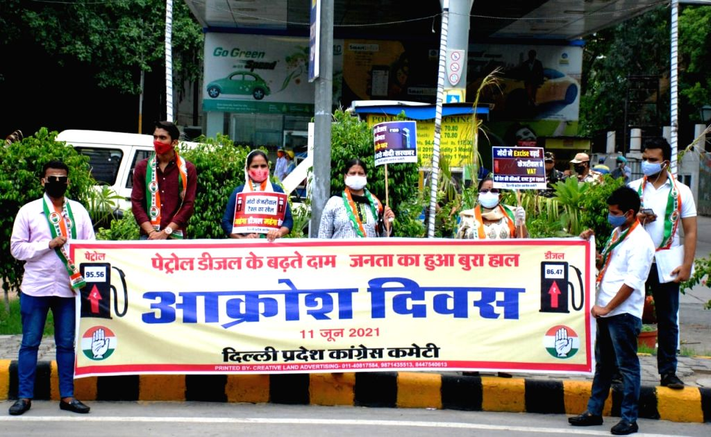 Delhi Pradesh Congress Committee President Ch. Anil Kumar participates in the protest against frequent hikes in the price of petrol and diesel, at all the petrol pumps across Delhi on ... - Kumar