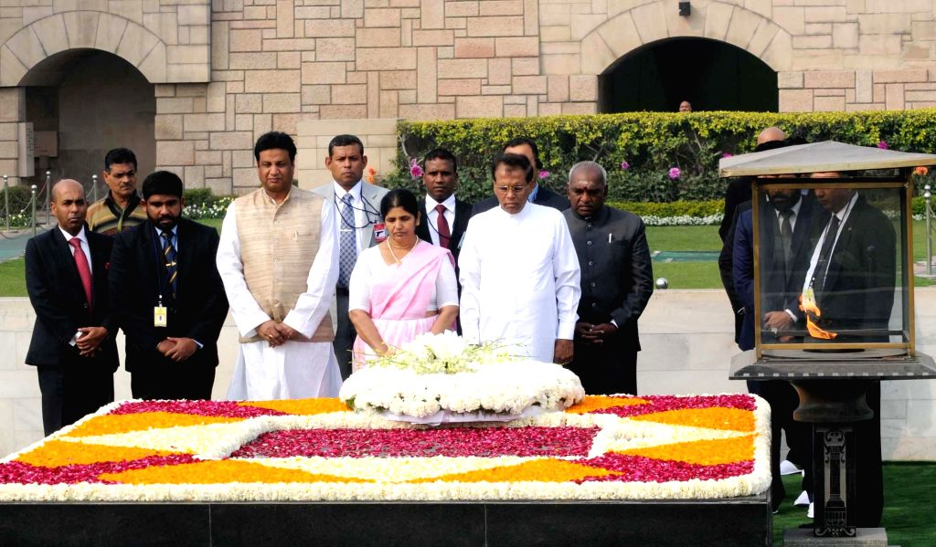 President of the Democratic Socialist Republic of Sri Lanka, Maithripala Sirisena and Jayanthi Sirisena pays homage at the Samadhi of Mahatma Gandhi, at Rajghat, in Delhi on Feb 16, 2015. The .