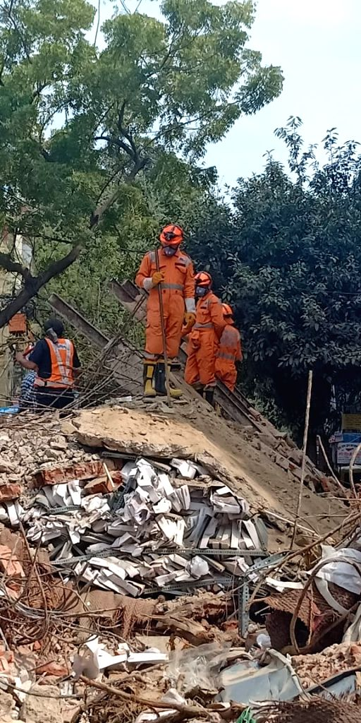 Delhi: Rescue work going on at the site of a four-storey building which collapsed in Karol Bagh, Delhi on Feb. 27, 2019. (Photo: IANS)