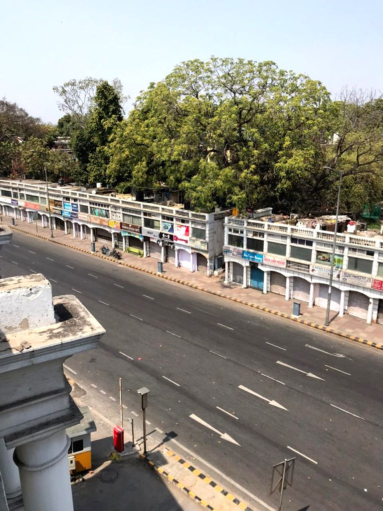 Delhi's Connaught Place bears a deserted look during the nationwide 'Janata Curfew' imposed in the wake of increasing cases of COVID-19 amid coronavirus pandemic, in New Delhi on March 22, ...