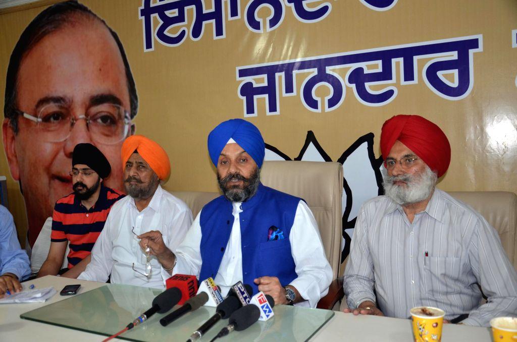 Delhi Sikh Gurdwara Management Committee president Manjit Singh G.K addresses a press conference in Amritsar on April 20, 2014.