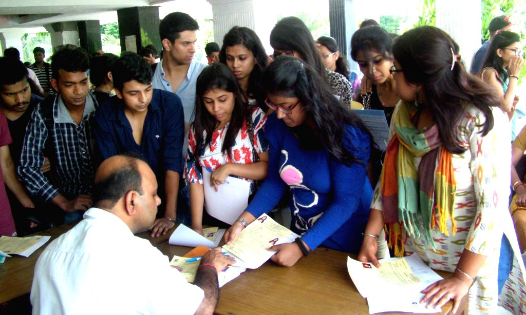 Delhi: Students arrive at a Delhi University college to submit their admission forms after the release of second cut off list at North Campus in Delhi on June 30, 2015. (Photo: IANS)