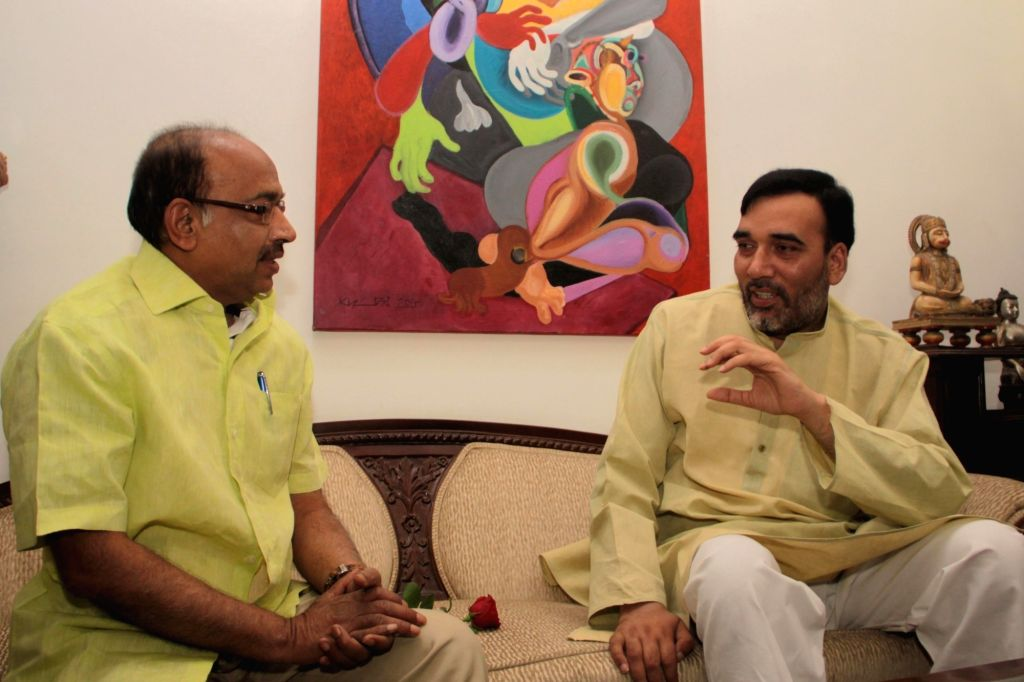 Delhi Transport Minister Gopal Rai meets BJP MP Vijay Goel at his residence to persuade him not to violate the odd-even traffic scheme aimed at battling pollution in New Delhi, on April ... - Gopal Rai
