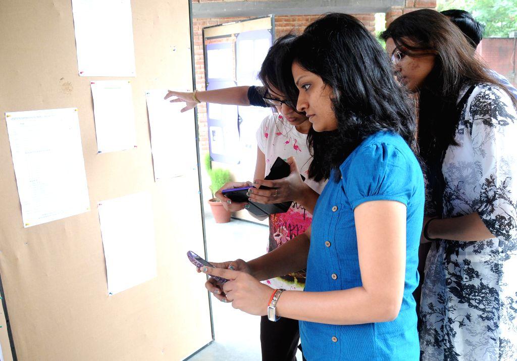Delhi University aspirants check out the first cutoff list at Miranda College, North Campus in North Delhi on June 25, 2015.