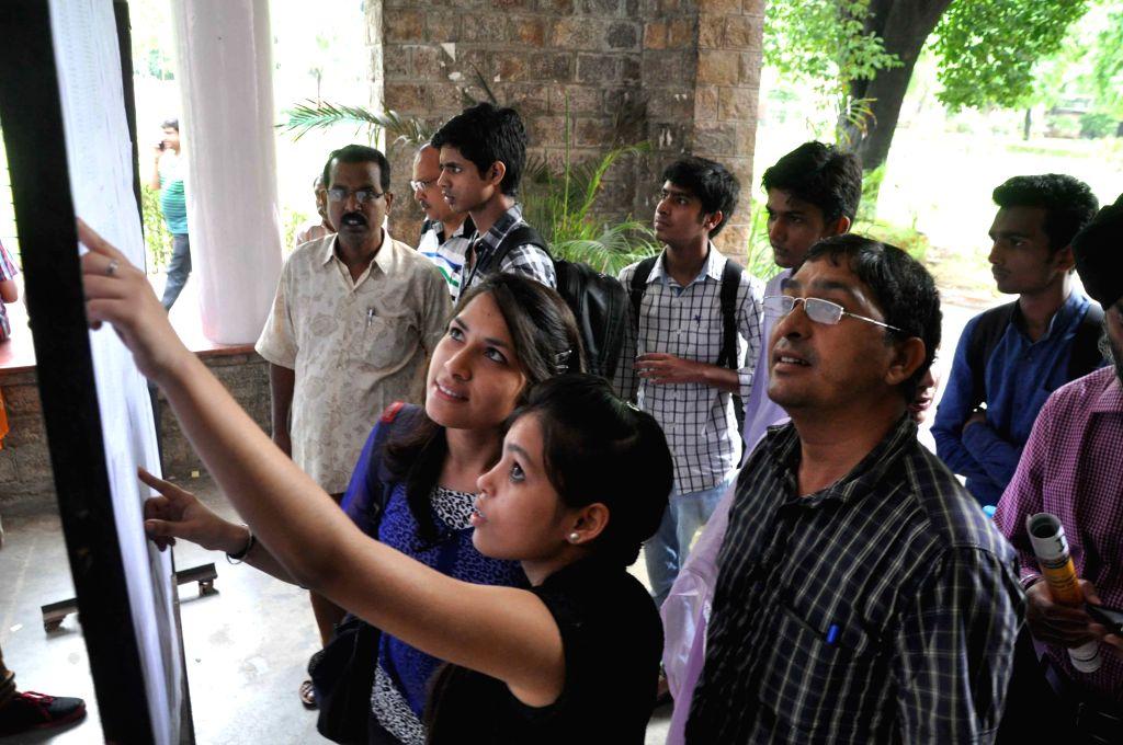 Delhi University aspirants check out the first cutoff list at Delhi University in New Delhi on June 25, 2015.