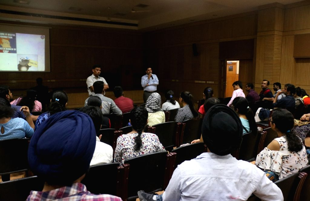 Delhi University officials conducting an open house discussion on admission process at Delhi University in New Delhi on June 1, 2018.