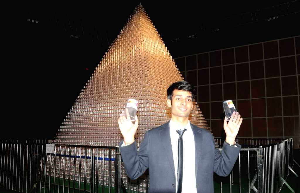 Delhi University student Kushagra Tayal created a new world record by making the largest plastic cup pyramid with his group members by Using 57,000 plastic cups at Tyagraj Stadium in New ...