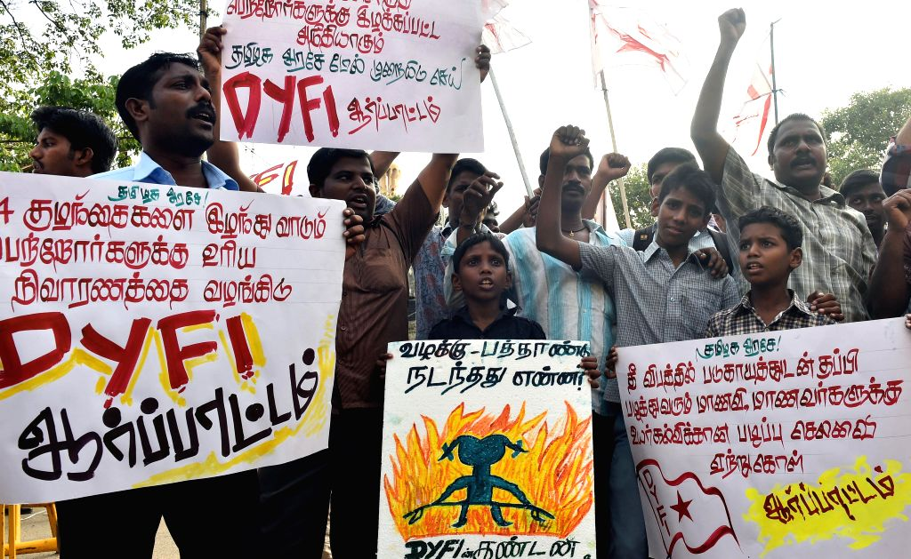 Democratic Youth Federation of India (DYFI) activists stage a demonstration in Chennai on July 31, 2014.