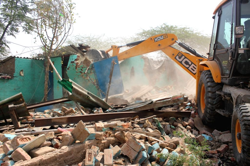 Demolition drive conducted by the enforcement team of Municipal Corporation of Gurugram (MCG), underway at Aravali Biodiversity Park, in Gurugram on May 23, 2018.
