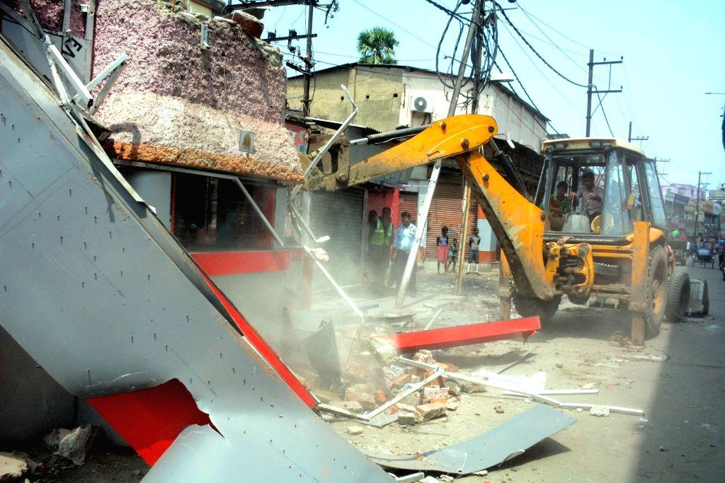 Demolition of illegal structures underway, in Patna on Sept 8, 2018.