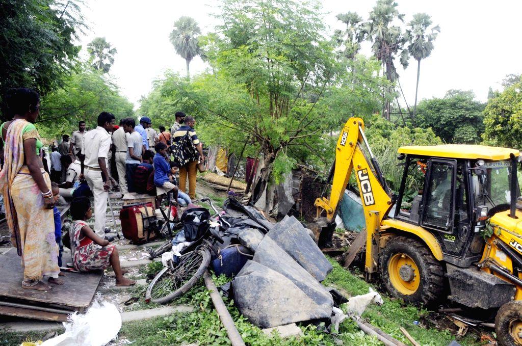 Demolition of illegal structures underway, in Patna on Sept 11, 2018.