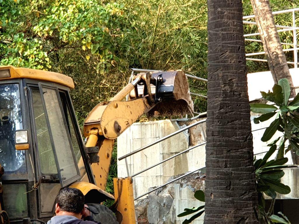 Demolition work at absconding diamantaire Nirav Modi's bungalow underway in Maharashtra's Raigad on Jan 25, 2019. A demolition squad led by SDO Alibaug, Sharada Powar, started work at around ... - Nirav Modi