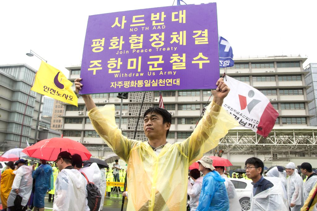 :Demonstrators attend a protest in Seoul, South Korea, on Aug. 15, 2017. South Korean people took to the streets in central Seoul on Tuesday to demand the ...