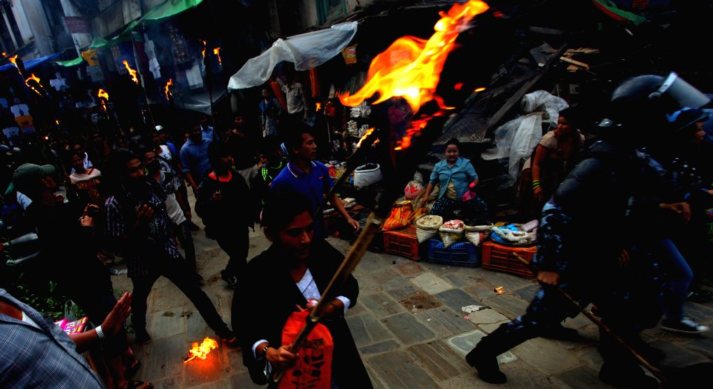 Demonstrators attend a torch rally on the eve of a two-day general strike  in Kathmandu, Nepal, Aug. 15, 2015. The disgruntled opposition parties called the ...
