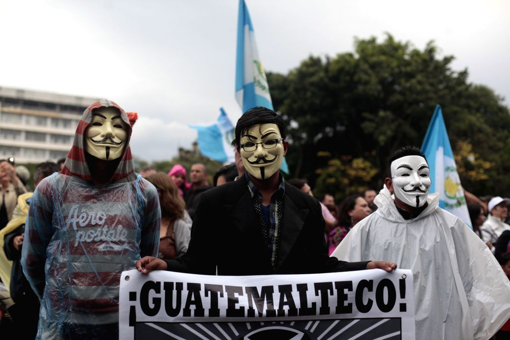 Demonstrators take part during an antigovernment protest, in Guatemala City, capital of Guatemala, on Aug. 15, 2015. According to local press, residents ...