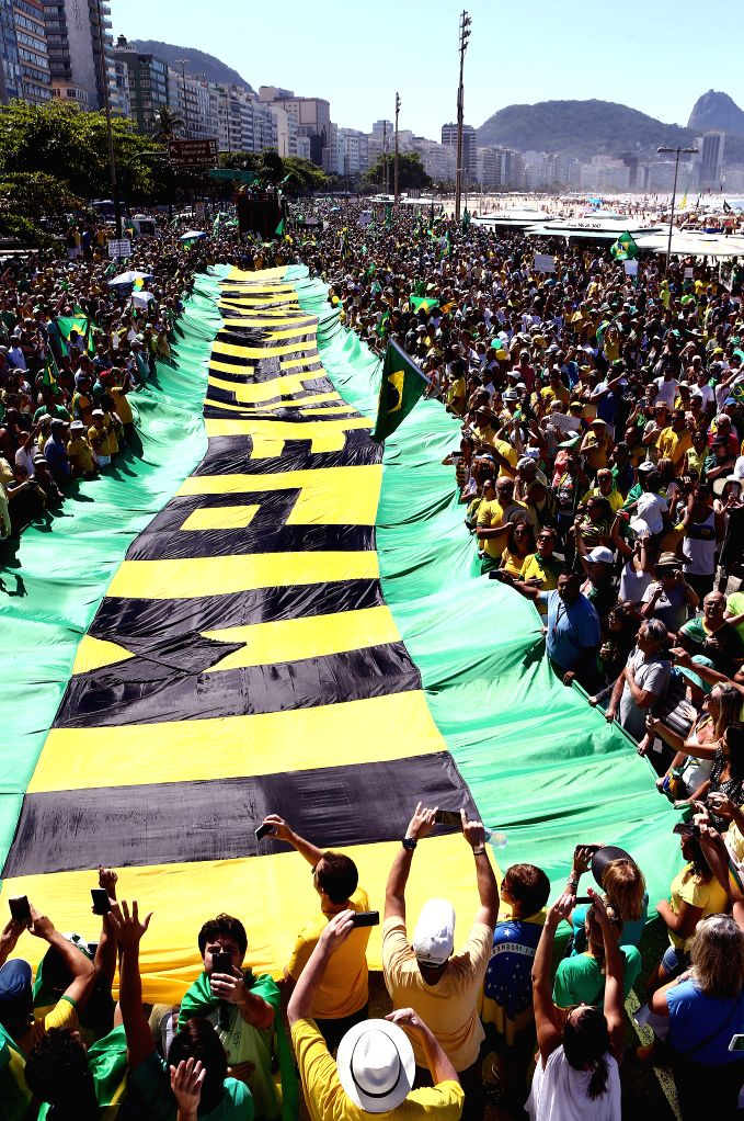 Demonstrators take part in a protest against the corruption scandal in Petrobras, growing economic hardship and in demand of the impeachment of Brazil's ...