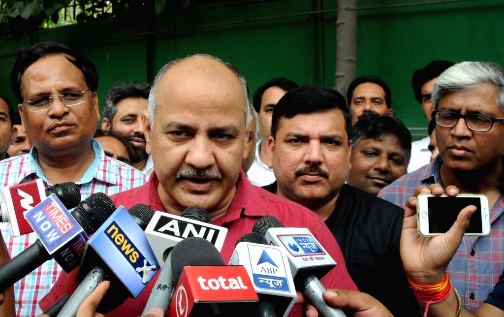Deputy Chief Minister Manish Sisodia who was detained by Delhi Police  along with other AAP legislators talks to press after being released  from Parliament Street Police Station in New ... - Manish Sisodia and Narendra Modi