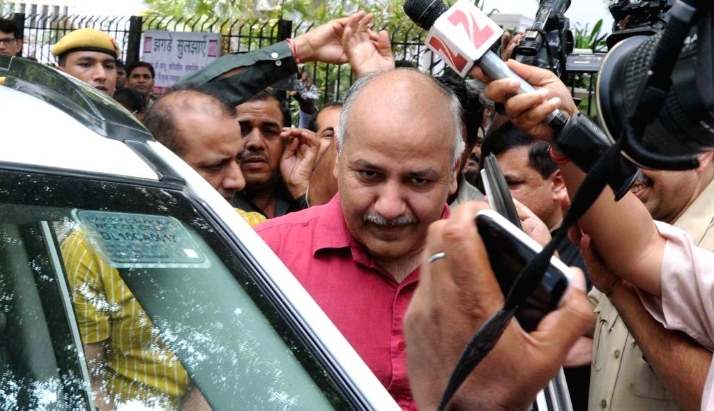 Deputy Chief Minister Manish Sisodia who was detained by Delhi Police  along with other AAP legislators after being released  from Parliament Street Police Station in New Delhi on June 26, ... - Manish Sisodia and Narendra Modi