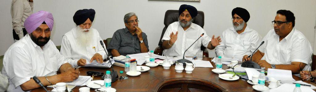 Deputy Chief Minister Punjab Sukhbir Singh Badal presiding over a high level meeting on governance reforms in Chandigarh on June 16, 2014. - Punjab Sukhbir Singh Badal