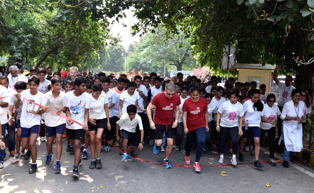 Deputy High Commissioner for Canada to India Jess Dutton (in red T-shirt) and Canada's High Commissioner for the Day, Medha Mishra (also in red T-shirt), join diplomats, students and ... - Medha Mishra
