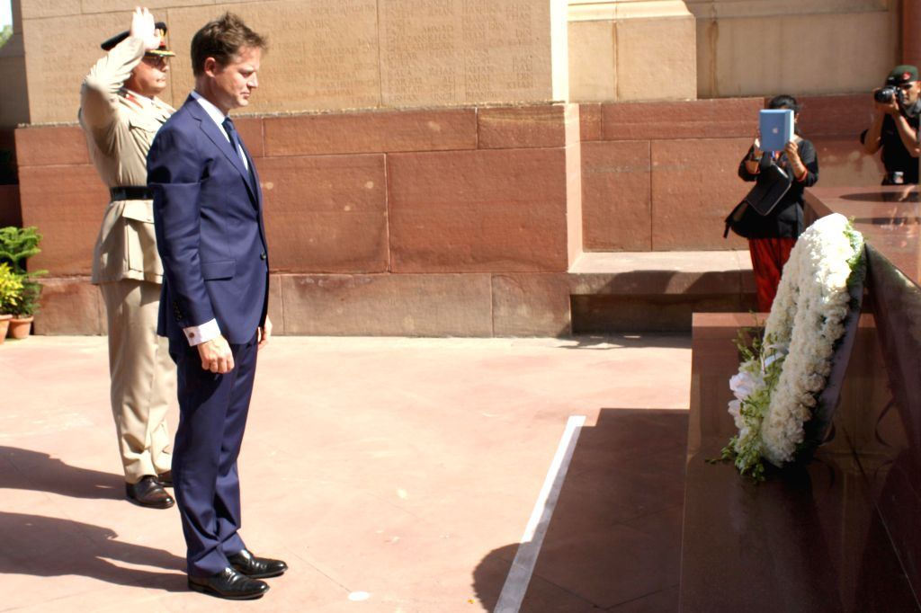 Deputy Prime Minister of United Kingdom Nick Clegg pays homage to unsung war heroes at Amar Jawan Jyoti, India Gate in New Delhi on Aug 25, 2014.