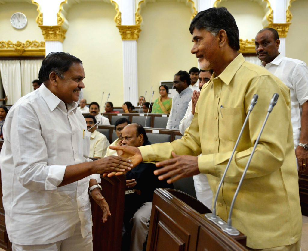 Deputy Speaker of the Andhra Pradesh Legislative Assembly Buddha Prasad with Andhra Pradesh Chief Minister N. Chandrababu Naidu inside the legislative assembly in Hyderabad on June 23, 2014.