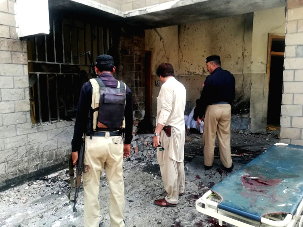 DERA ISMAIL KHAN, July 21, 2019 (Xinhua) -- Photo taken with a mobile phone shows officials inspecting the blast site in northwest Pakistan's Dera Ismail Khan on July 21, 2019. A string of terrorist attacks on police in Pakistan's northwest Dera Isma - Dera Ismail Khan