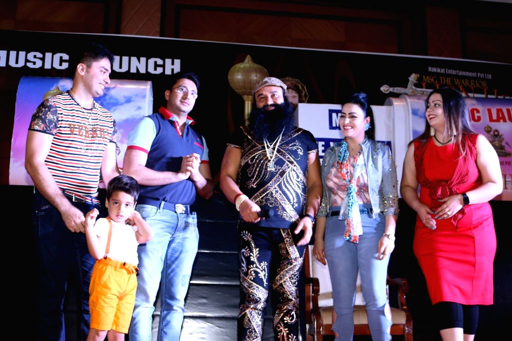 Dera Sacha Sauda (DSS) spiritual head Gurmeet Ram Rahim Singh along with his family during the music launch of the film MSG The Warrior Lion Heart in Mumbai on Sept. 17, 2016.