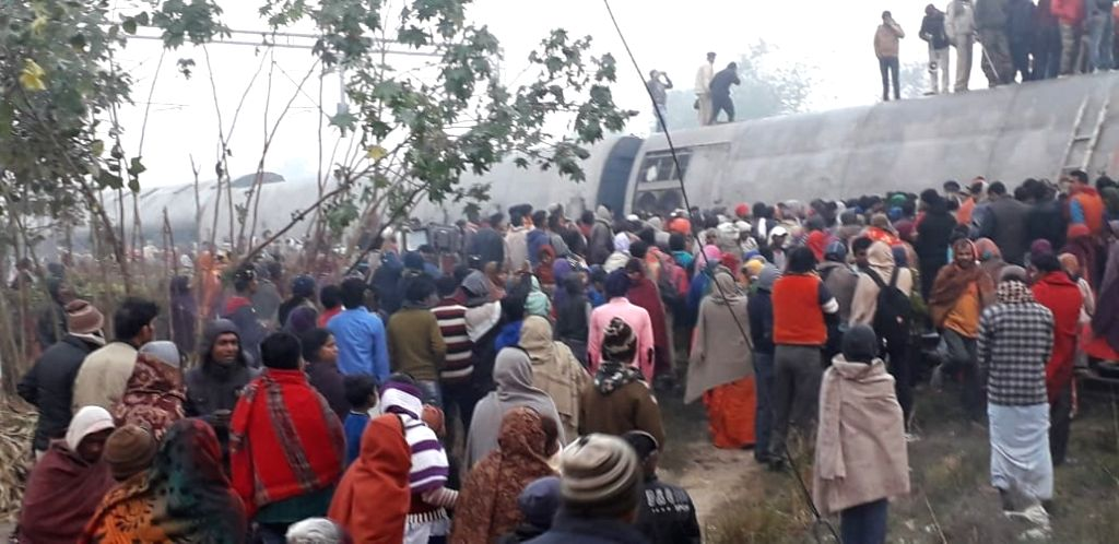 Derailed compartments of Delhi-bound Seemanchal Express seen at the accident site at Bihar's Vaishali district on Feb. 3, 2019. At least six persons were killed and 10 injured when nine ...