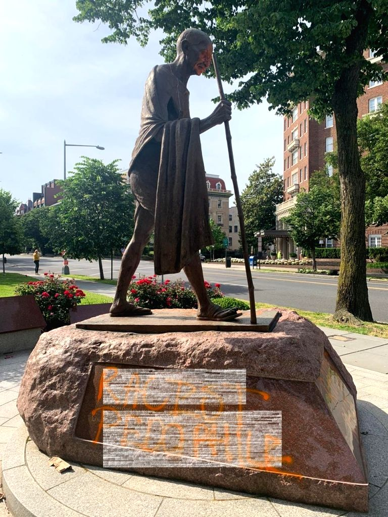 Desecrated Gandhi statue in Washington being cleaned. - Gandhi