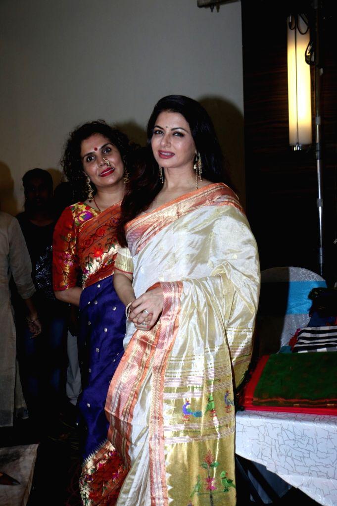 Designer Shraddha Sawant with actress Bhagyashree at 'Exhibition of Looms' organised by her label Massakali Sarees, in Mumbai on Aug 24, 2019. - Bhagyashree