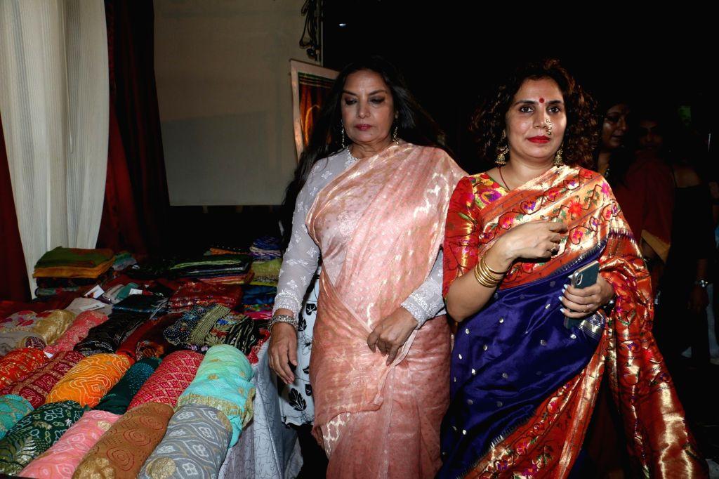 Designer Shraddha Sawant with actress Shabana Azmi at 'Exhibition of Looms' organised by her label Massakali Sarees, in Mumbai on Aug 24, 2019. - Shabana Azmi