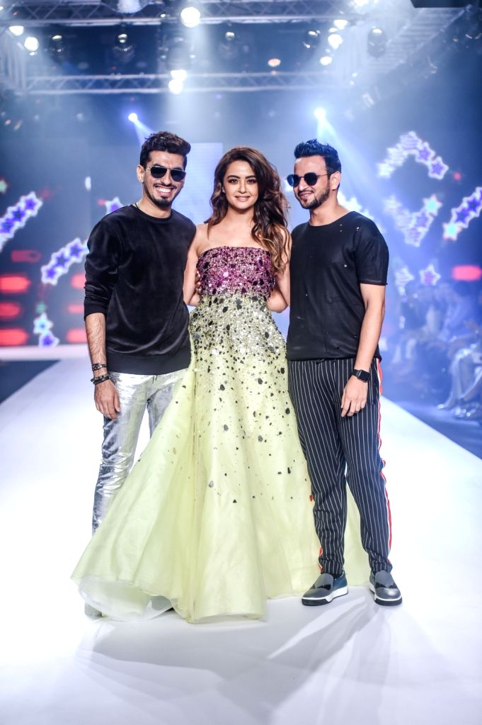 Designers Karl and Leo with actress Surveen Chawla during their show on the second day of Bombay Times Fashion Week 2018, in Mumbai on March 31, 2018. - Surveen Chawla