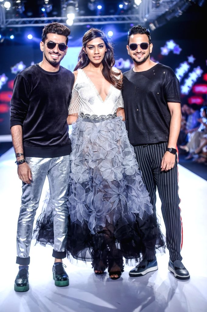 Designers Karl and Leo with model Apeksha Porwal during their show on the second day of Bombay Times Fashion Week 2018, in Mumbai on March 31, 2018. - Apeksha Porwal