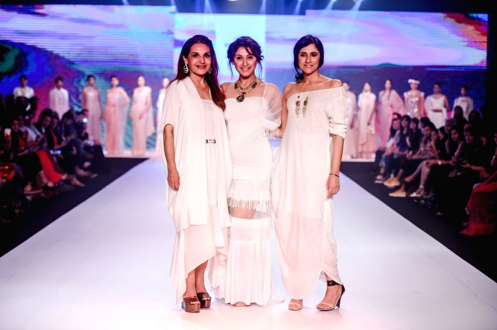Designers Rina Dhaka and Poonam Soni with actress Manjari Phadnis during their show on the second day of Bombay Times Fashion Week 2018, in Mumbai on March 31, 2018. - Manjari Phadnis