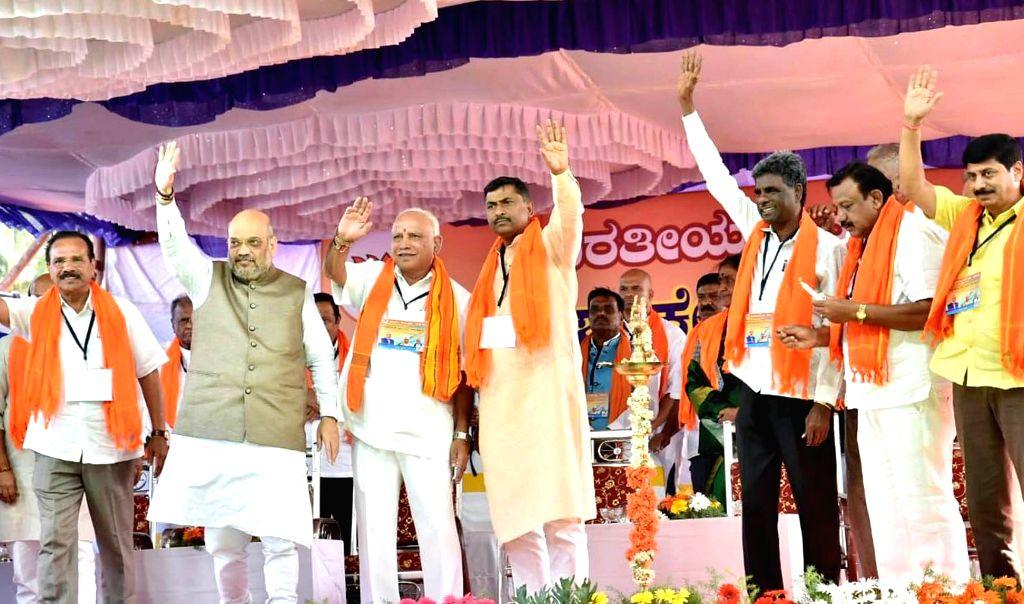 Devanahalli: BJP chief Amit Shah addresses a party meeting in Karnataka's Devanahalli, on Feb 21, 2019. (Photo: IANS) - Amit Shah