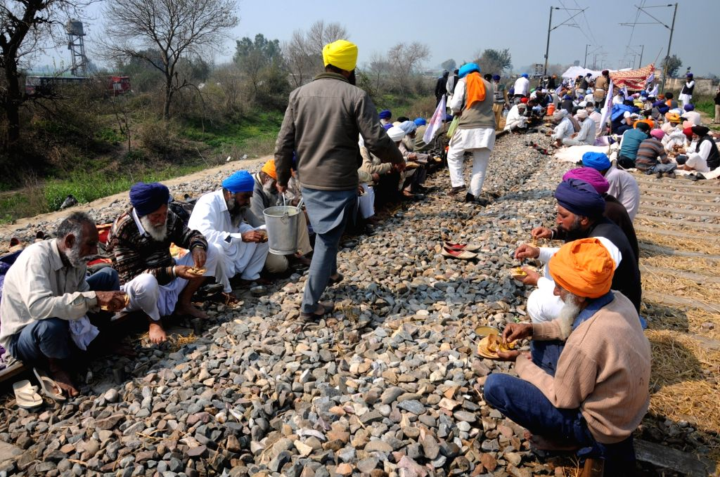 Devi Dass Pura: Farmers stage a sit-in demonstration on railway tracks to press for various demands, including the implementation of the recommendations of the Swaminathan Commission report at ...