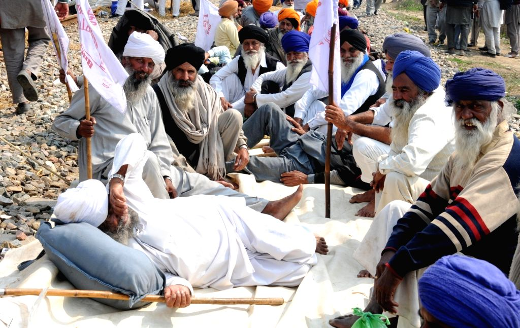 Devi Dass Pura: Farmers stage a sit-in demonstration on railway tracks to press for various demands, including the implementation of the recommendations of the Swaminathan Commission report at village Devi Dass Pura, near Amritsar, Punjab on March 5,