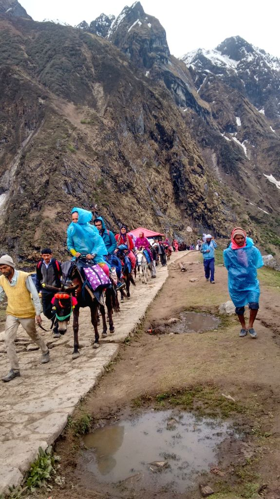 Devotees arrive at Badrinath.
