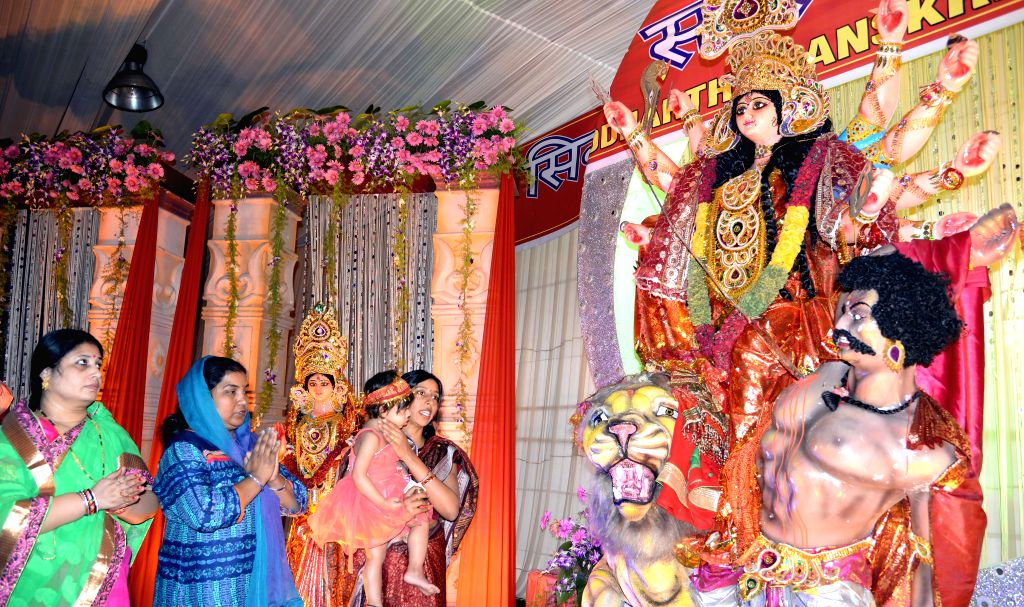 Devotees at a Durga Puja pandal in Bengaluru, on Oct 21, 2015.