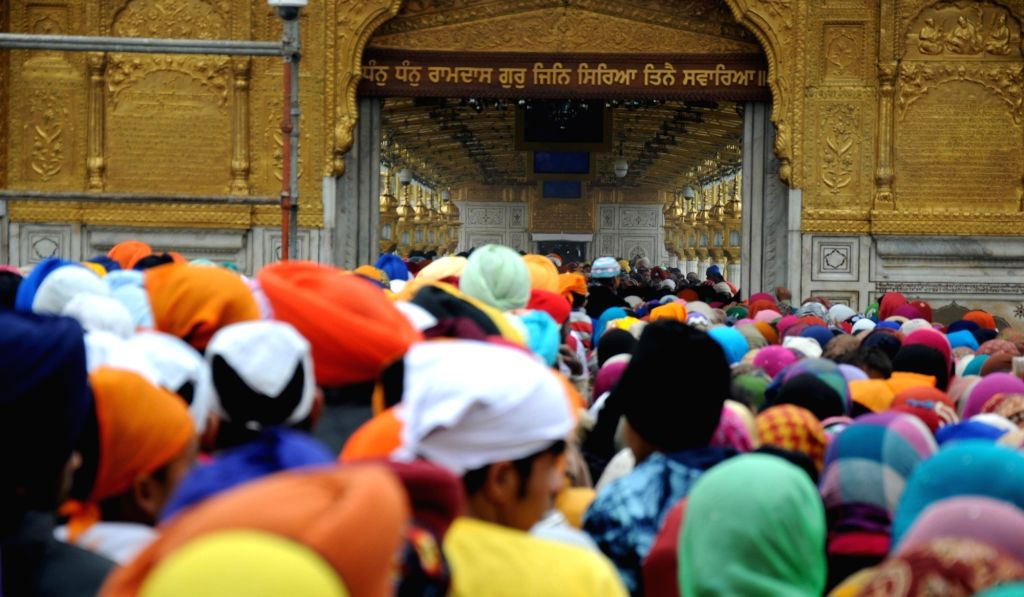Devotees at the Golden Temple on the occasion of birth anniversary celebration of the 10th Sikh Guru Gobind Singh in Amritsar on Jan 16, 2016.