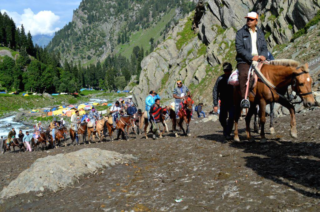 Devotees begin their pilgrimage to the Amarnath Yatra at Pahalgam in Anantnag district of Jammu and Kashmir on July 2, 2015.
