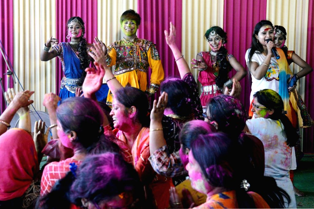 Devotees dance with traditional songs at Shyam Mandir on the occasion of Holi festival celebration in Kolkata on March 21, 2021