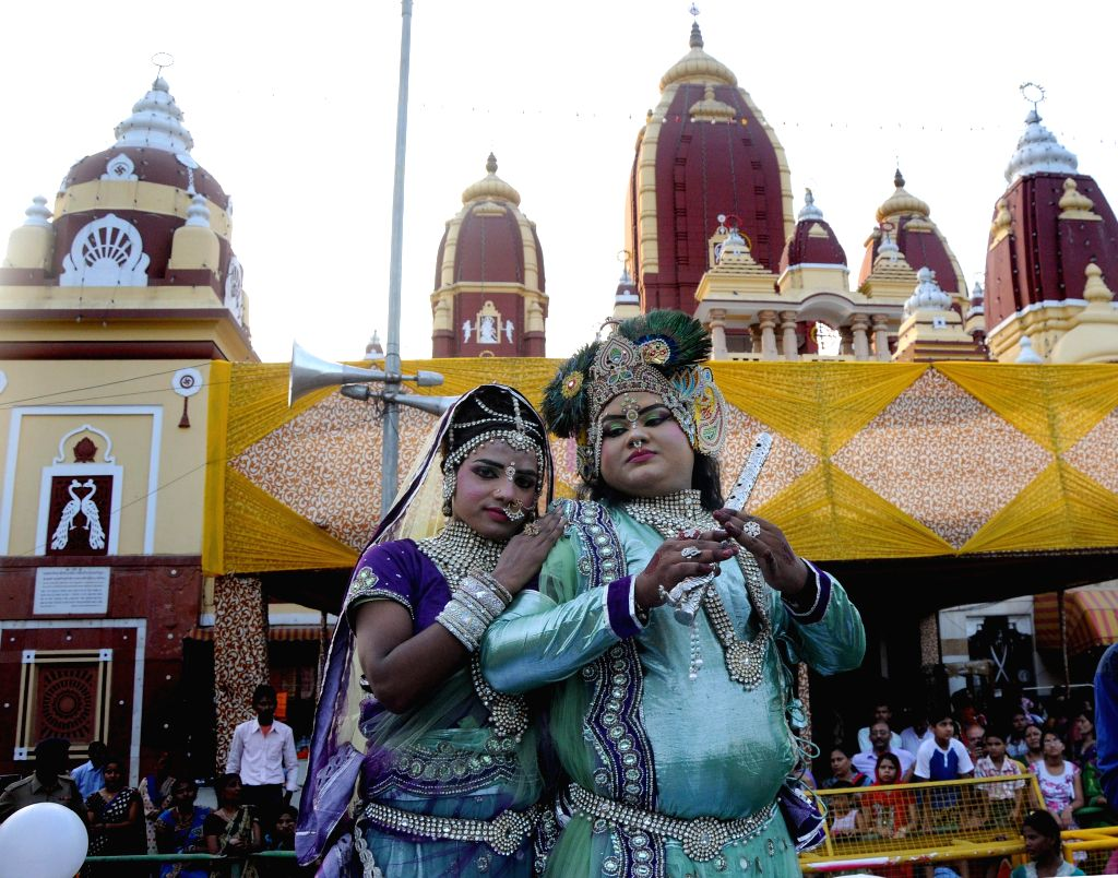 Devotees disguised as lord Krishna and Radha during a `shobha yatra` organised on Janmashtami in New Delhi on Aug 17, 2014.