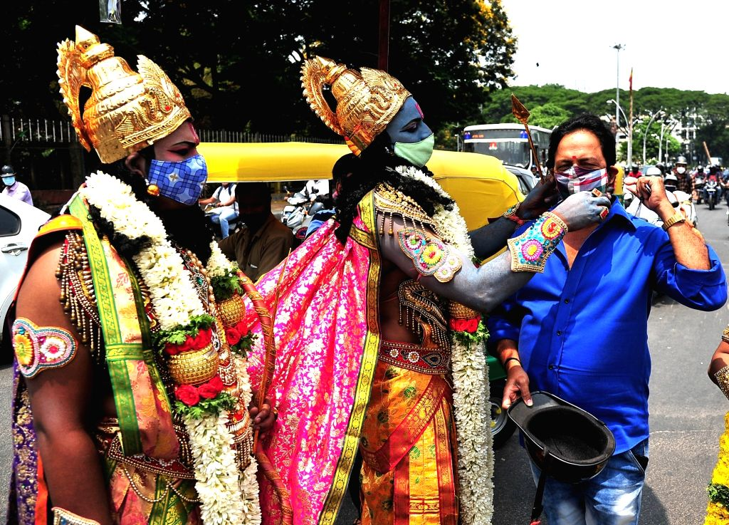 Devotees dressed like Lord Sri Rama and Lord Hanuman distribute face masks during the Coronavirus Pandemic, on the eve of Sri Ramanavami Festival near Anand Rao Circle, in Bengaluru on Wednesday 21st ... - Anand Rao Circle