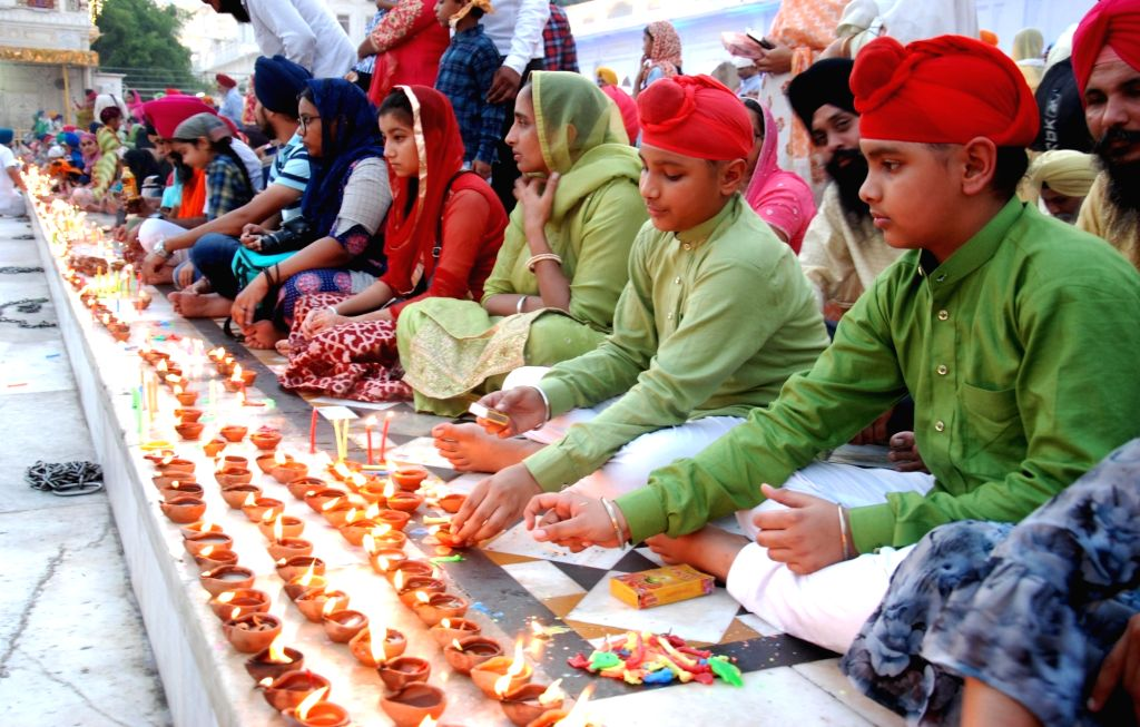 Devotees during Diwali celebrations, at Golden Temple in Amritsar on Oct 27, 2019.
