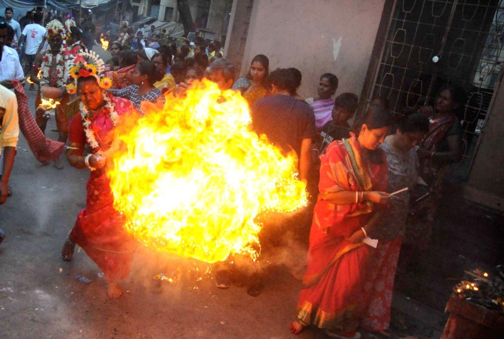 Devotees during 'Gajan' festival in Kolkata, on April 13, 2019.